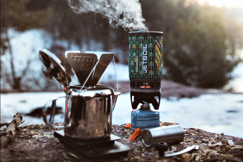 Set up a camping coffee station for a streamlined process in the morning